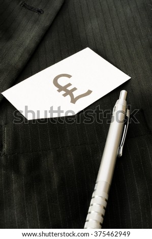 Business card with the sign BRITISH POUND  - stock photo
