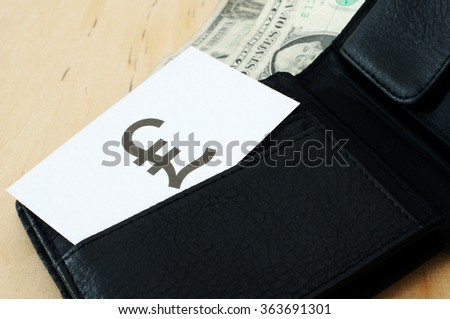 Business card with the sign BRITISH POUND in wallet with dollars   - stock photo