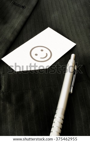 Business card with the sign SMILEY  - stock photo
