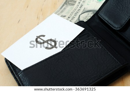 Business card with the sign US DOLLAR in wallet with dollars   - stock photo