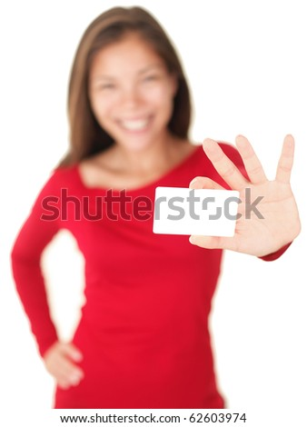Business card woman holding a blank gift card isolated on white background. Out of focus person showing or giving an empty sign. - stock photo
