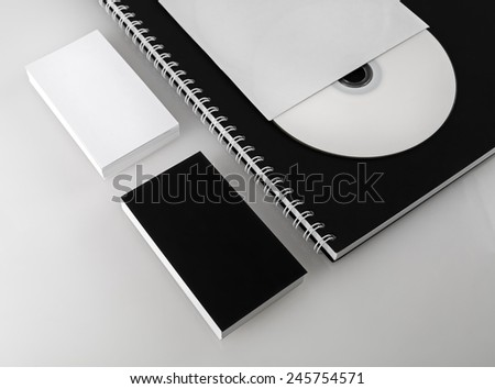 Business cards, compact disc and notepad. Template for branding identity for designers. Shallow depth of field. - stock photo
