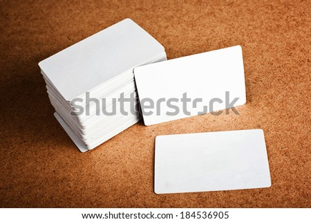 Business cards with rounded corners. Stack of blank horizontal business cards propped up another with copy space for your design. Please, browse my portfolio for more blank business cards images. - stock photo