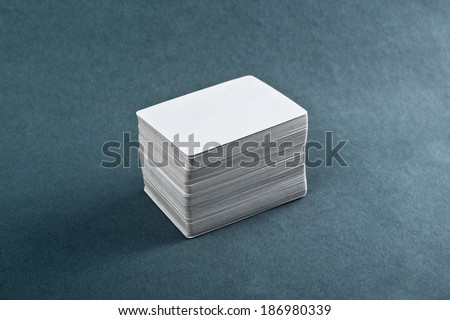 Business cards with rounded corners. Stack of blank horizontal business cards propped up another with copy space for your design - stock photo