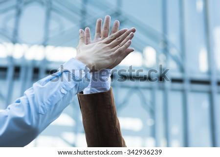 Business celebration for good teamwork with a high-five - stock photo