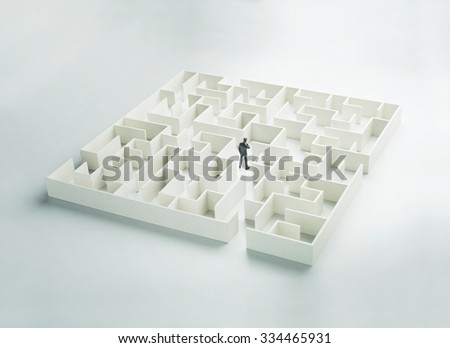 Business challenge. A businessman navigating through a maze. Rear view - stock photo