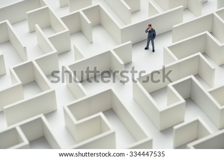 Business challenge. A businessman navigating through a maze. Top view - stock photo