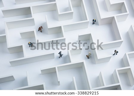 Business challenge. Businessmen navigating through a maze - stock photo