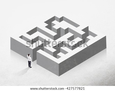 Business challenge concept represented by a businessman thinking how to overcome concrete maze - stock photo
