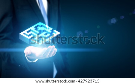 Business challenge concept represented by businessman hand holding abstract illuminated maze - stock photo