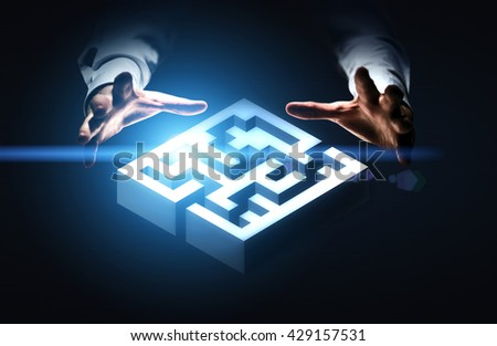 Business challenge concept represented by hands grabbing abstract illuminated maze - stock photo