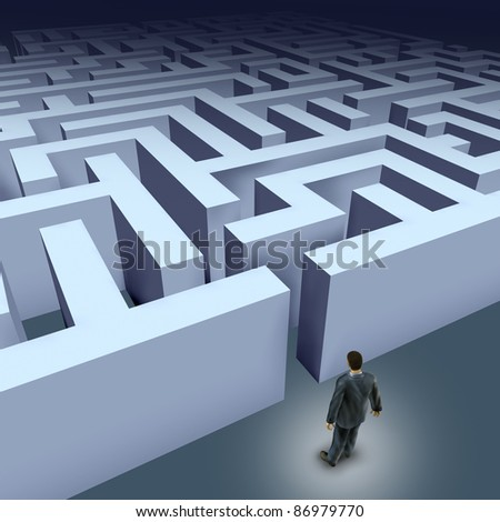 Business challenges represented by a business man facing a maze showing the concept of challenges ant starting a journey using strategy and planning so you do not get lost. - stock photo