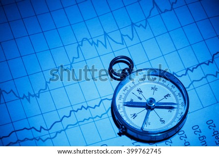 Business chart and compass, concept of growth guide. - stock photo