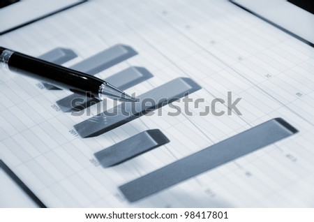 business chart and touch screen tablet-pc - stock photo