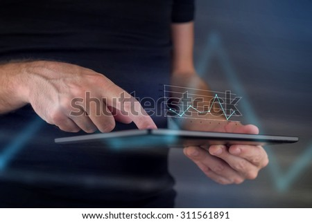 Business chart diagram on digital tablet computer, hands tapping touch screen to view financial report. - stock photo