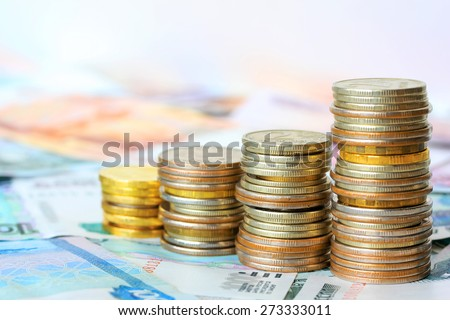 Business chart is made from coins, shows an increase