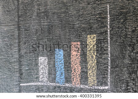 Business chart on blackboard showing increase in sales - stock photo
