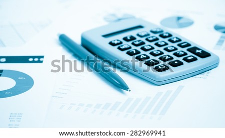business chart showing financial success at the stock market.  Blue toned - stock photo