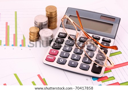 business chart showing financial success, glasses and calculator - stock photo