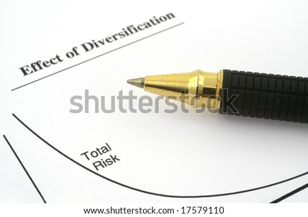business chart with total risk and ballpoint pen - stock photo
