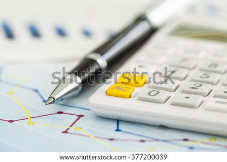 Business charts and calculator - stock photo