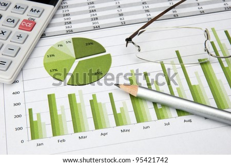 Business Charts Green with calculator, glasses and pen - stock photo