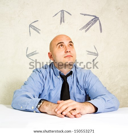 Business choice or business making decisions. Businessman looking at arrows above him. Concept of choice, choosing between possible solutions.