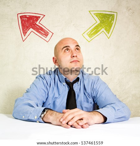 Business choice or making decision. Businessman looking at arrow above him. Concept of choice, choosing between possible solutions.