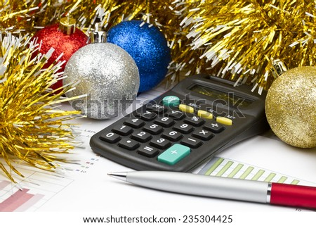 Business Christmas of red balls, pen, calculator, tinsel - stock photo