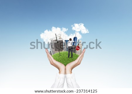 Business city center and businessman on hands - stock photo