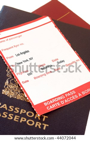 Business class  boarding pass from Los Angeles to New York city on passport on white background