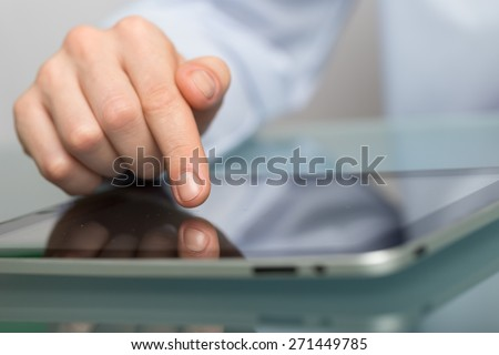 Business. Close up of male hand using digital tablet - stock photo