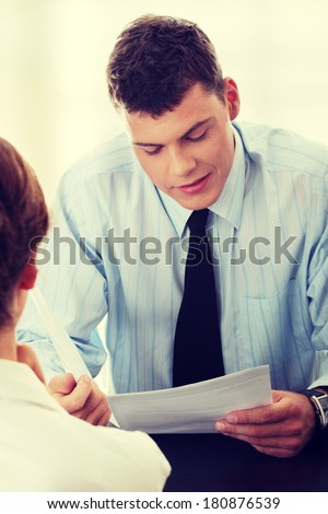 Business coaching concept. Young woman being interviewed for a job. - stock photo