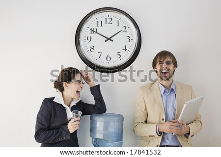 Business colleagues conversing at water cooler - stock photo