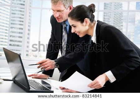 Business colleagues discussing a new project - stock photo
