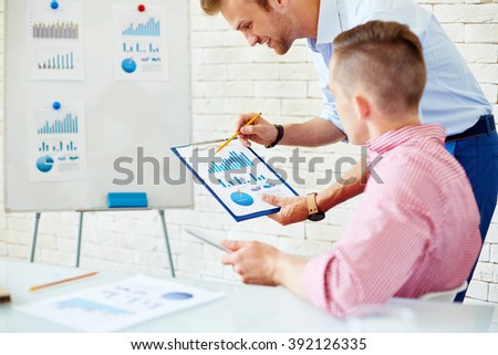 Business colleagues discussing business strategy together - stock photo