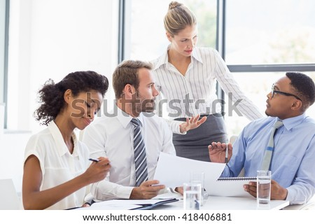Business colleagues discussing in meeting at office - stock photo
