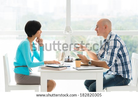 Business colleagues discussing problems of the company at meeting  - stock photo