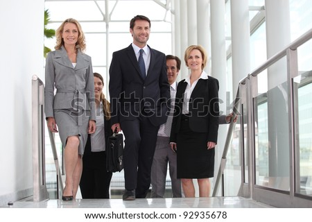 Business colleagues going to meeting - stock photo