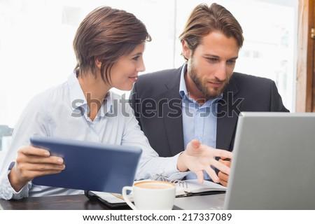 Business colleagues having a meeting at the coffee shop - stock photo