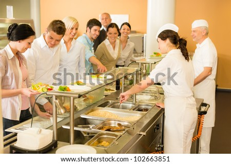 Business colleagues in cafeteria cook serve fresh healthy food meals - stock photo