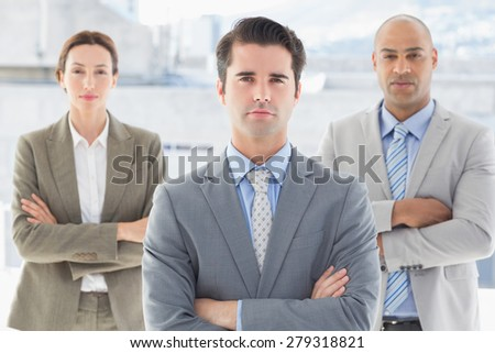 Business colleagues looking at camera in the office - stock photo