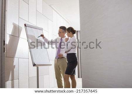 Business colleagues planning for presentation in office - stock photo