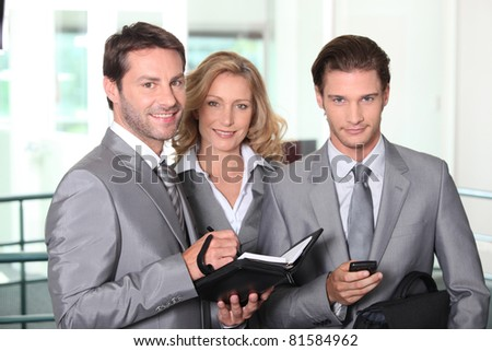 Business colleagues smiling - stock photo