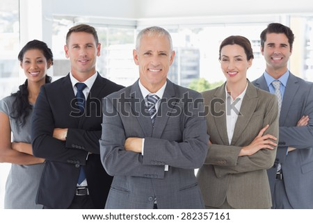 Business colleagues standing in a row in the office - stock photo