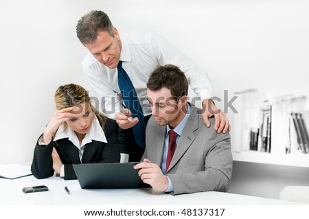 Business colleagues working hard together during a meeting in office - stock photo