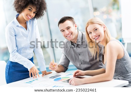 Business colleagues working in office - stock photo