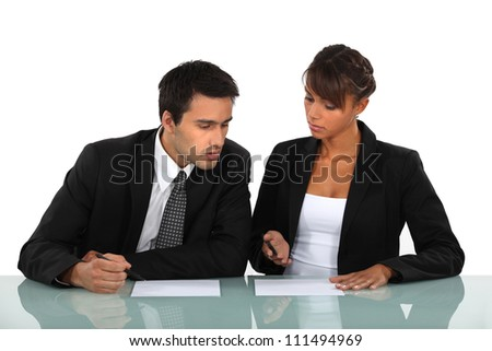 business colleagues working in the office - stock photo