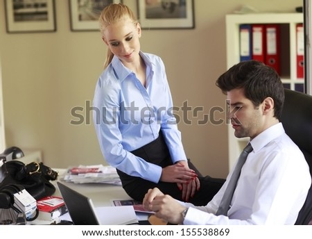 Business colleagues working on laptop in office. Shallow focus.