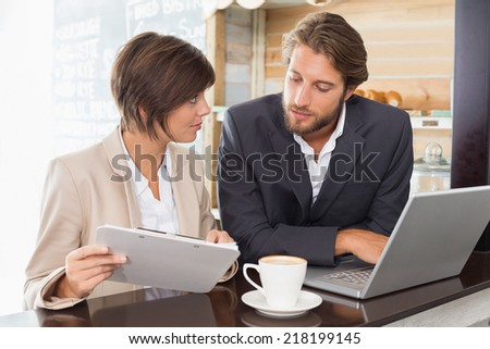 Business colleagues working on their break at the coffee shop - stock photo
